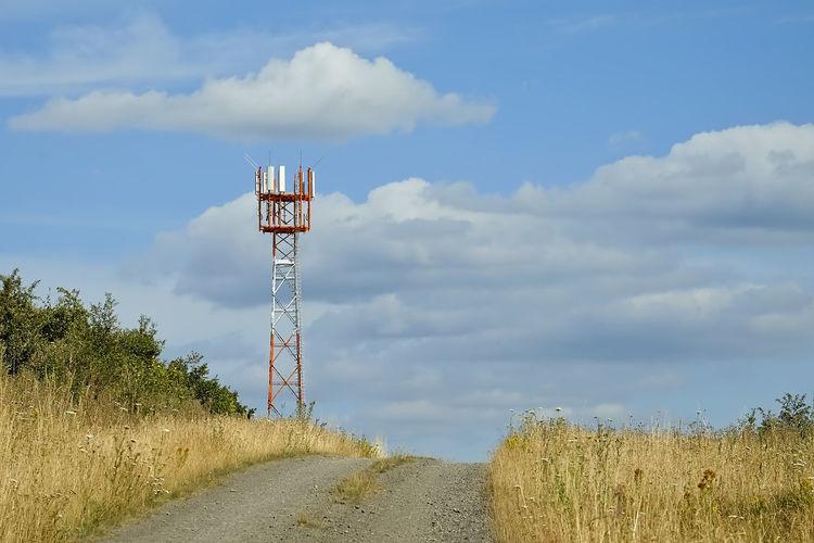 5g radio mast on field against sky