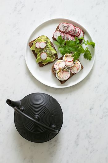 High Angle View Of Open Sandwiches In Plate On Table