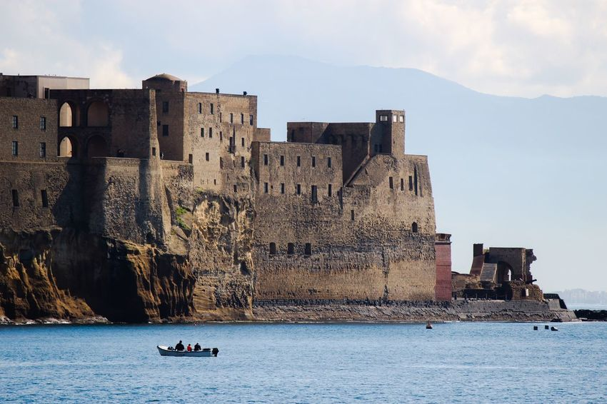 Napoli Castel dell'Ovo Water Architecture Waterfront Built Structure Real People Sky Building Exterior Sea Day Nature Outdoors Leisure Activity Nautical Vessel Transportation Vacations Lifestyles Scenics Beauty In Nature Men One Person City Life Napoli ❤ City Napoli Naples