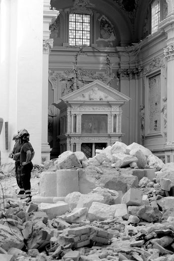 L'Aquila earthquake: firemen on the ruins inside the church of Collemaggio Abruzzo L'Aquila Rubble Wall Arch Architectural Column Architecture Black And White Blackandwhite Building Exterior Built Structure Church Architecture Earthquake Earthquake In Italy Earthquake L'aquila Firemen Firemen At Work Full Length History Indoors  Monument Place Of Worship Real People Rear View Religion Spirituality