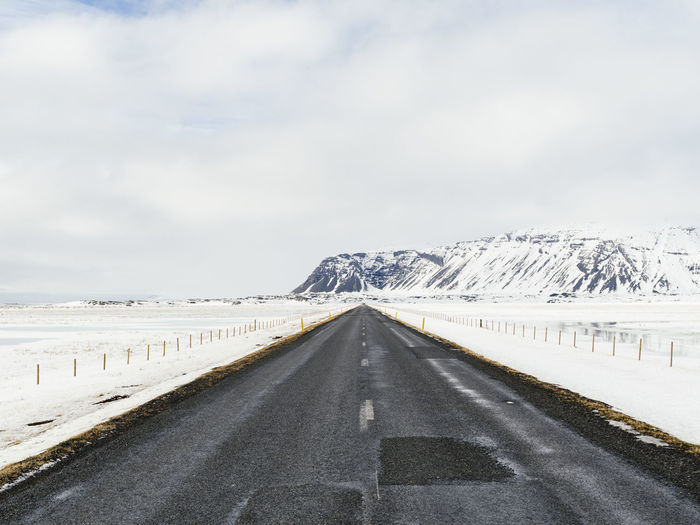 Iceland Iceland Memories Beauty In Nature Cloud - Sky Cold Temperature Country Country Road Day Diminishing Perspective Direction Iceland_collection Mountain Nature No People Outdoors Road Scenics - Nature Sky Snow Snowcapped Mountain The Way Forward Winter