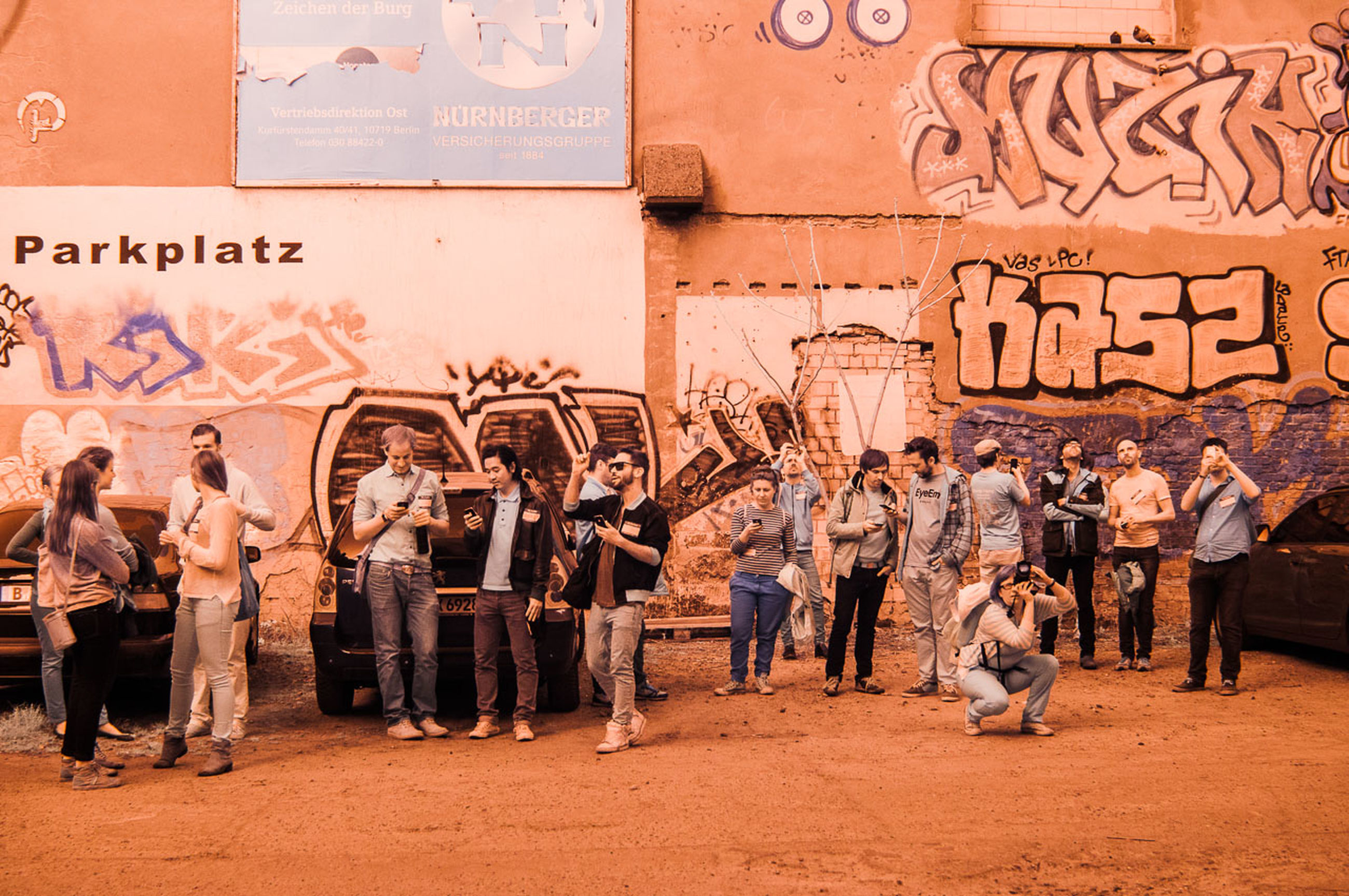 graffiti, art, art and craft, text, creativity, men, architecture, built structure, wall - building feature, building exterior, street art, person, large group of people, western script, human representation, animal themes, horse, communication, livestock