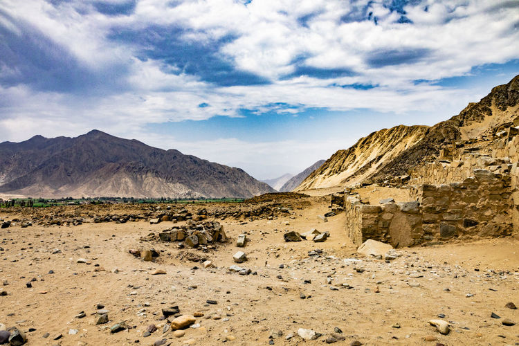 Caral, Lima, Peru, most ancient civilization in the Americas. Sky Cloud - Sky Scenics - Nature Mountain Beauty In Nature Environment Landscape Tranquil Scene Tranquility Mountain Range Nature Non-urban Scene Rock Land Day No People Solid Remote Arid Climate Desert Climate Outdoors Formation Argiculture