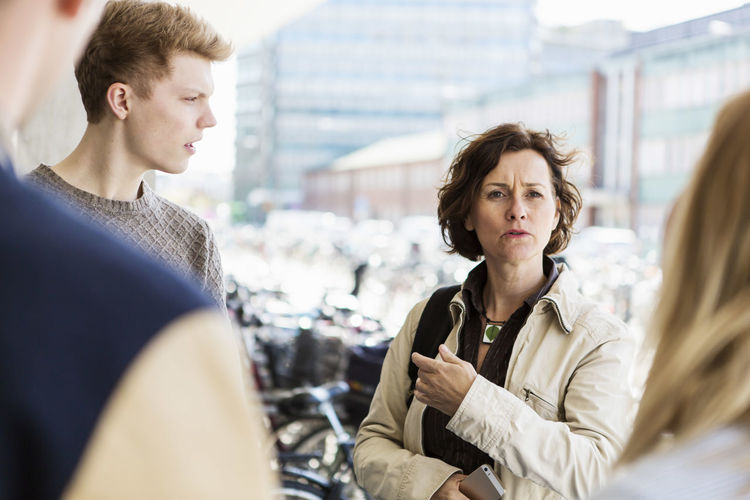 Portrait of a young couple looking at city