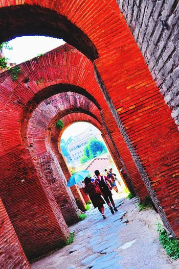 Umbrella In The Sun Redbricks Redstones History Real People Architecture Built Structure Men Walking Arch Leisure Activity People