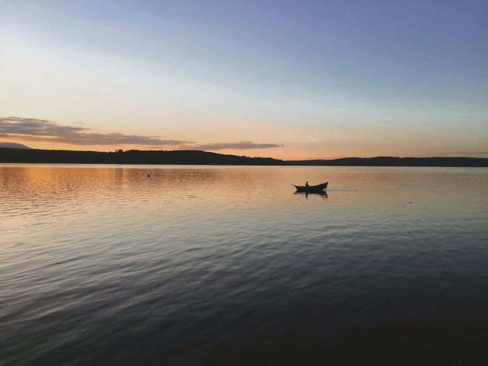 Lonely fisherman rowing against the sunset at Kitsap National Park in Poulsbo, Washington. Taken with an iphone 6 plus. Animal Themes Beauty In Nature Dusk Gone Fishing Hood Canal Iphone 6 Plus IPhoneography Iphoneonly Kitsap Lake Kitsap Peninsula Lake Nature Nautical Vessel No People Orange Sky Outdoors Peaceful Reflection Row Boat Sunset Tranquil Scene Tranquility Water First Eyeem Photo