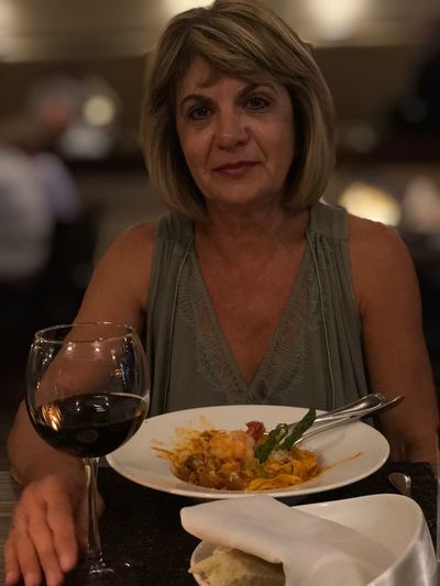 Portrait of a woman eating food in restaurant