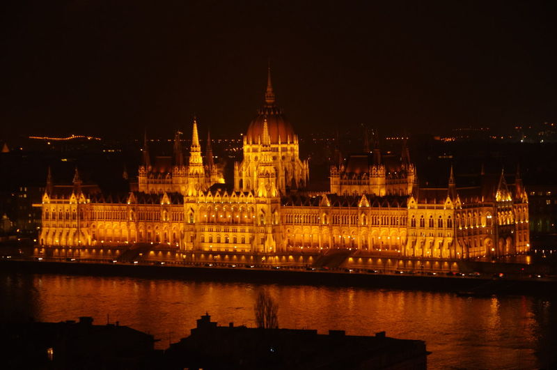 Hungarian Parliament Building at night, Budapest, Hungary Architecture Budapest Built Structure City Cultures Danube EyeEmNewHere Gothic Revival Government Hungary Illuminated Landmark Night No People Old Buildings Orange Color Politics And Government Reflection River Travel Destinations Water