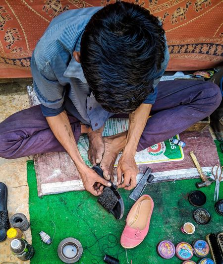 Cobblers' Shop... EyeEm Selects Cobbler's Tools Cobbler At Work Men High Angle View 17.62° The Art Of Street Photography
