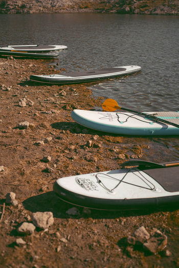 High angle view of boats moored on shore