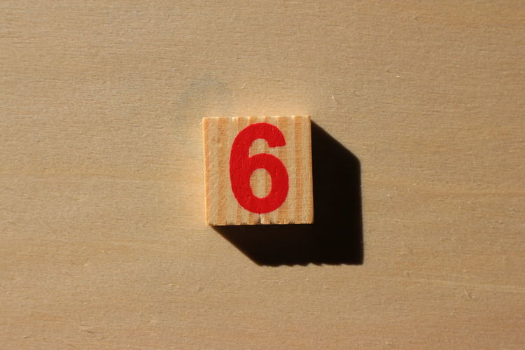 Close-up of number 6 on wood