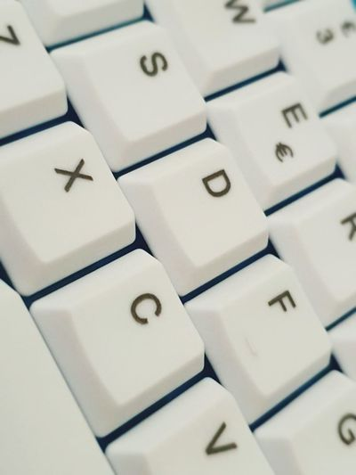 Working Work Computer Key Computer Keyboard Alphabet Full Frame White Color Close-up Cube Shape Worker Text Window Washer Written Capital Letter Board Information Information Sign Cubicle
