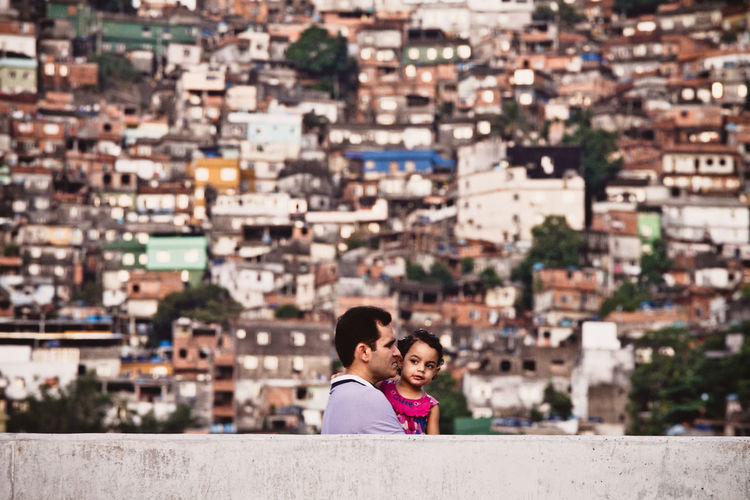 Father carrying his daughter in the Rocinha Favela - Rio de Janeiro, Brazil Rio De Janeiro Eyeem Fotos Collection⛵ Rocinha Summertime Tourist Attraction  Vacations Architecture Building Exterior Built Structure Childhood City Cityscape Day Favela Focus On Foreground Lifestyles Outdoors Parents People Real People Retaining Wall Summer Togetherness Tourism Tourist Destination Two People