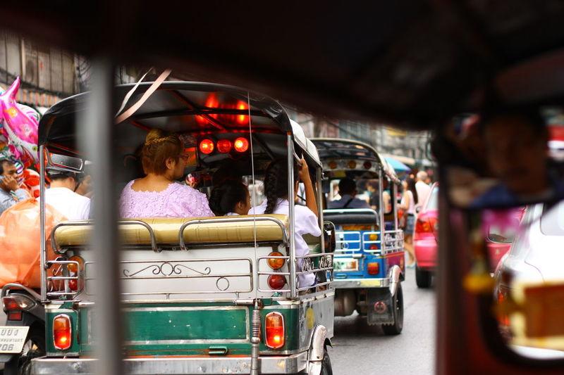 Rear view of auto rickshaws on road