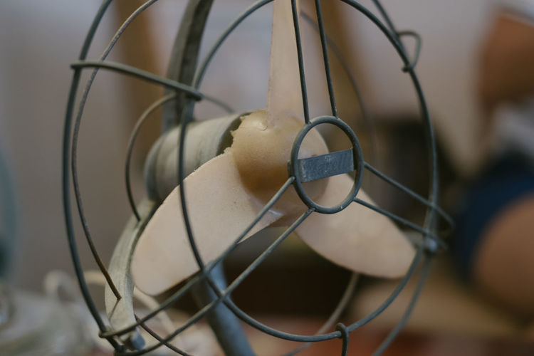 Close-up of electric fan on table