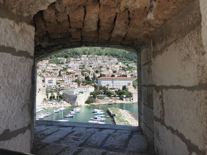 view from inside the city wall Harbour Harbor Harbour View Boats Window Old Ruin Water Arch Architecture Built Structure Building Exterior Stone Wall Historic Stone Material History