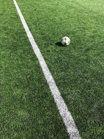 High angle view of soccer ball on field