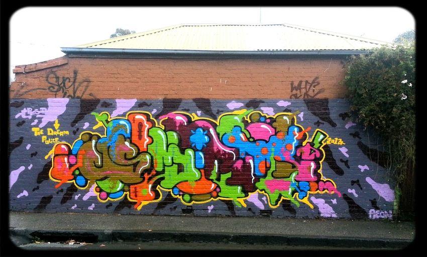 Trim sdm Graffiti Streetart on the side of a house. good enough to eat
