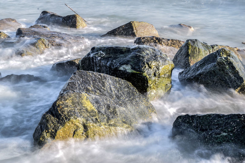 High angle view of rocks amidst sea