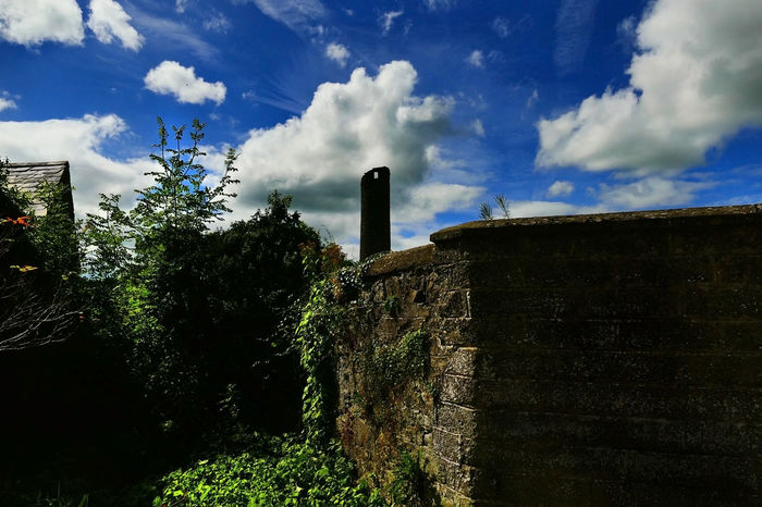 Ancient Round Tower, Clones, Co. Monaghan, Ireland. Ancient Structure Architecture Blue Built Structure Cloud Cloud - Sky Cloudy Day Deterioration Grass Green Color Growth Landscape Low Angle View Nature No People Outdoors Plant Round Tower Sky Tranquility The Great Outdoors - 2017 EyeEm Awards