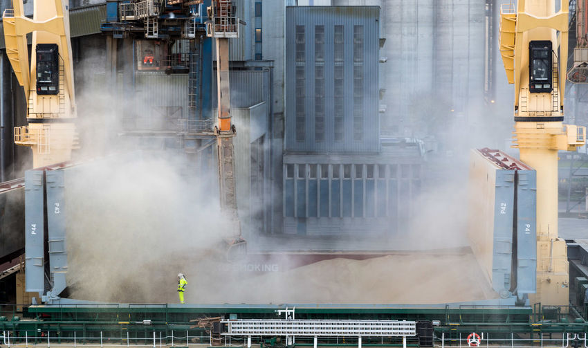 Smoke - Physical Structure Architecture Industry Building Exterior Built Structure Steam Factory City Heat - Temperature Day Nature Outdoors Motion No People Machinery Water Industrial Building  Business Environmental Issues Pollution Industrial Equipment Air Pollution
