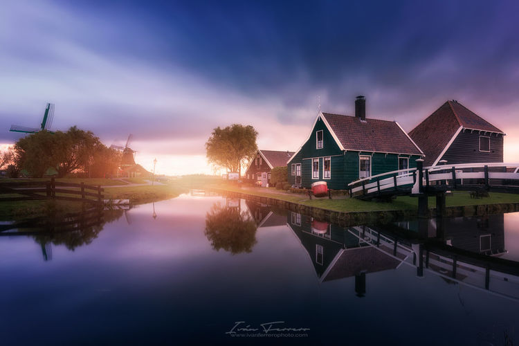 An incredible location in Amsterdam nearby (Holland) Architecture Building Exterior Built Structure Day Holland House No People Outdoors Reflection Scenics Sky Sunset The Great Outdoors - 2017 EyeEm Awards Tranquility Water Windmill