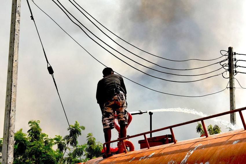 Fire Engine Cloud Of Smoke Extinguish Extinquisher Fire Engine Man Trying To Extinguish Sugarcane Plantation Fire Put Out Fire Sugarcane Plantation Fire Water