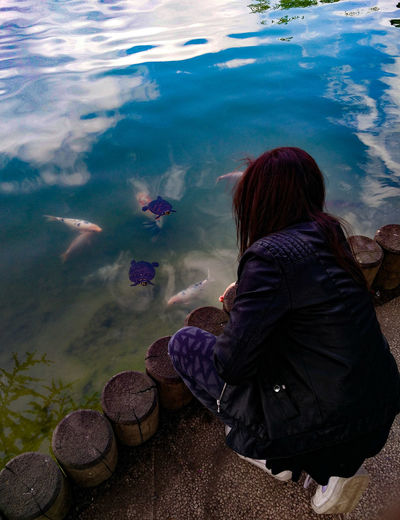 Young Adult One Woman Only Outdoors Reflection Lake 2017 May2017 Water Animal Themes Fish Turtles Blue Lake Colourful Carpe Perspectives On Nature