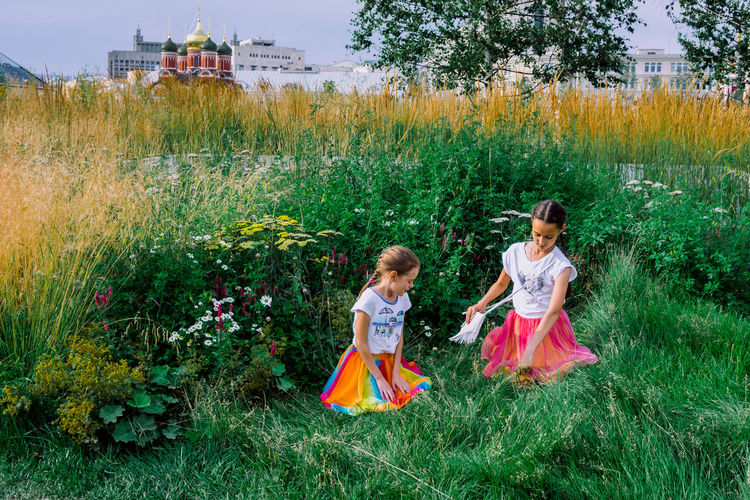 Plant Grass Child Childhood Girls Females Full Length Women Nature Land Real People Day Field Dress Green Color People Tree Two People Walking Fashion Innocence Outdoors Sister My Best Photo