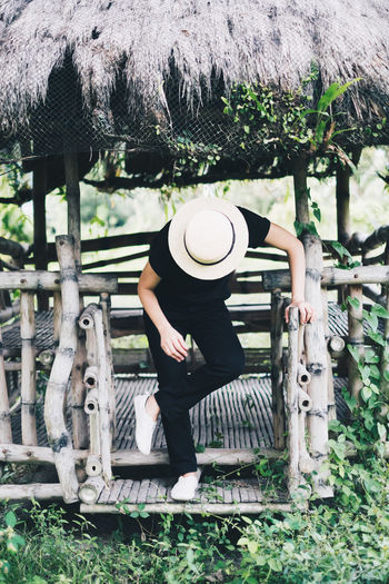 One Person Real People Hat Full Length Day Casual Clothing Lifestyles Clothing Nature Leisure Activity Outdoors Adult Architecture Built Structure Wood - Material Obscured Face Unrecognizable Person Unisex Black Color Portrait Bending Fashion Model Travel Vacation My Best Photo International Women's Day 2019 Exploring Fun
