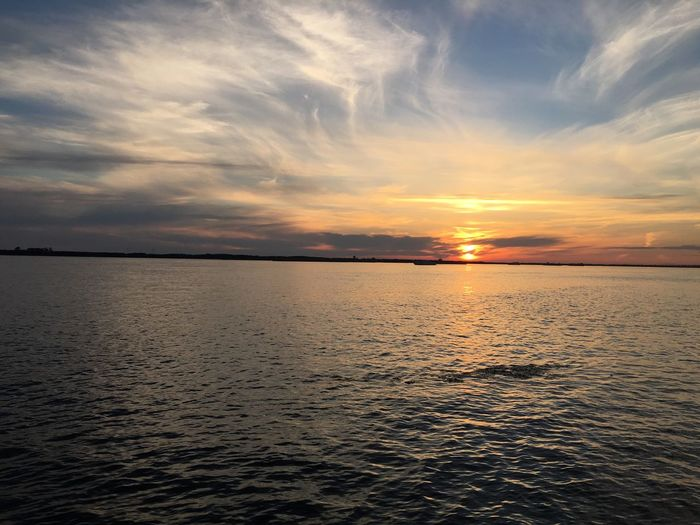 Sunset Scenics Water Tranquil Scene Beauty In Nature Tranquility Idyllic Sea Nature Sky Cloud - Sky Majestic Cloud Orange Color Waterfront Sun Dramatic Sky Non-urban Scene Atmospheric Mood Tourism Amur