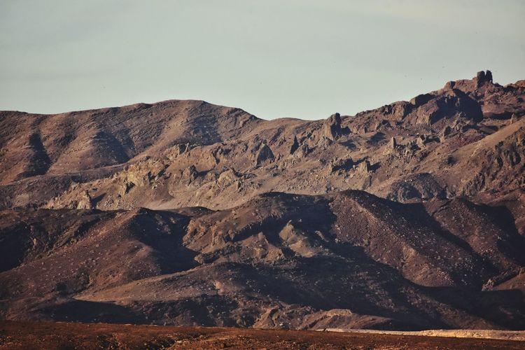 volcanic mountains on fuerteventura canary island in Spain Fuerteventura Canary Islands Desert Sky Landscape Arid Landscape Geology Rugged Rock Formation Cliff Natural Landmark