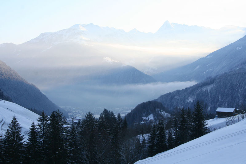 Mountains in Maxyrhofen in Zillertal, Austria Cat Cloud Cold Cold Temperature Finkenberg Focus On Foreground House Mayrhofen Mist Morning Light Morning Sky Mountain Mountain Range Mountains Nature No People Outdoors Snow Valley Water Winter Zillertal Zillertal Alps