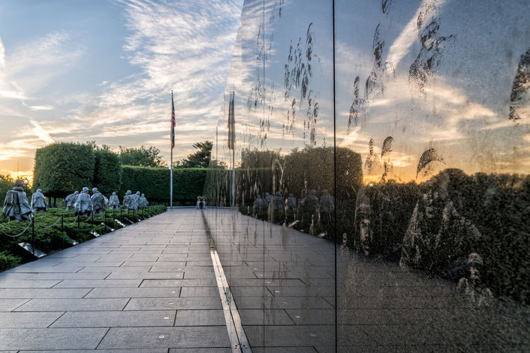 Reflecting on the past at the Korean War Veterans Memorial. Clouds Clouds And Sky Korean War Memorial, Washington Memorial Nature Orange Color Reflections Remember Sunrise