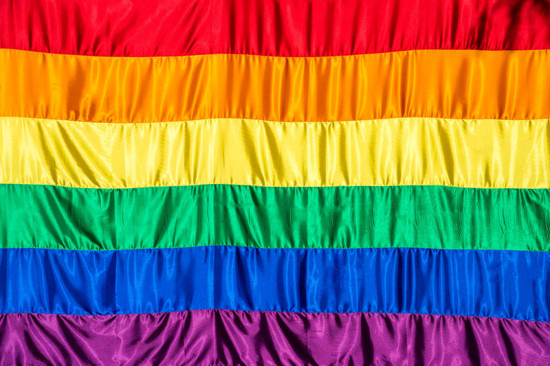 Close up of a giant rainbow flag with many wrinkles Background Backgrounds Fabric Gay GAY FLAG Gay Rainbow Flag Multi Colored No People Pattern Rainbow