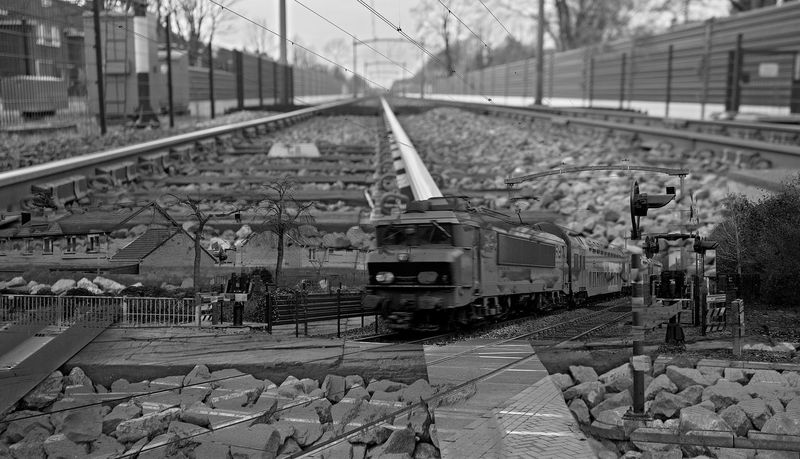 tracks and train Black And White Blackandwhite Blackandwhite Photography Mode Of Transport Montage No People Outdoors Public Transportation Rail Transportation Railroad Track Railway Railway Track Special Edit Train - Vehicle Transportation Travel Railway Crossing