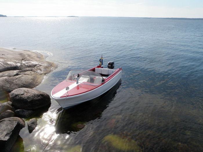 Motorboat Moored In Sea Against Sky
