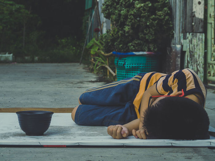 One Person Real People Child Childhood Lifestyles Day Relaxation Lying Down Men Boys Males  Leisure Activity Sleeping Casual Clothing Food And Drink Full Length Sitting Focus On Foreground Portrait Outdoors EyeEmNewHere