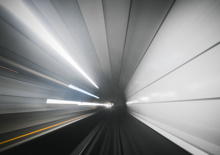 Abstract Architecture Blurred Motion Ceiling Diminishing Perspective Direction Illuminated Indoors  Long Exposure Mode Of Transportation Motion Moving Walkway  No People on the move Public Transportation Rail Transportation Speed Subway Subway Train The Way Forward Track Transportation Travel Tunnel vanishing point