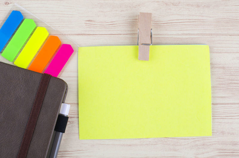 Yellow sticky paper and diary with pen on wooden background Adhesive Note Note Multi Colored Reminder Pen Indoors  Wood - Material Paper Table No People Writing Instrument Still Life Directly Above Office Blank Close-up Choice Copy Space Note Pad High Angle View Color Swatch Art And Craft Equipment