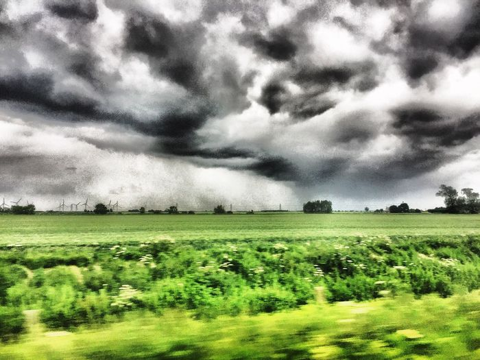 The view from a Train window as we race ahead of the storm that is brewing, Train Window View Landscape Nature Field Sky Cloud - Sky Beauty In Nature Storm Cloud Green Color Scenics Grass Day
