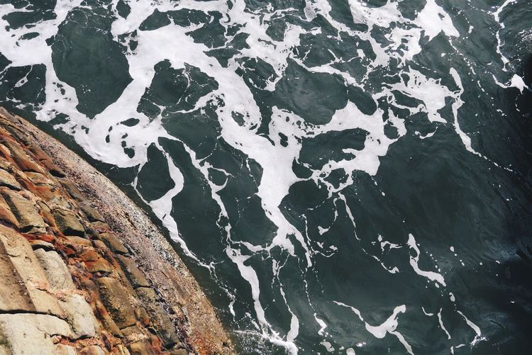 Directly Above View Of Cliff In Sea