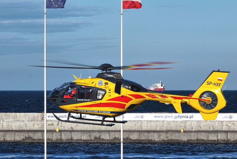 Ec135 Eurocopter Medical Rescue Helicopter Poland Gdynia Sar Rescue Helicopter View  Helicopter Water Flag Transportation Sea Nature No People Day