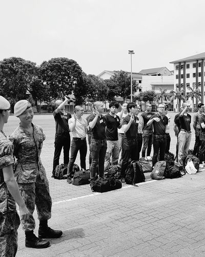 They were told to wave goodbye. This was the most painful moment in my life so far. My Son Enlistment Day National Service Bnwsingapore Bnwphotography Bnwstreetphotography Sg_streetphotography Streetphotography Tekong Singapore