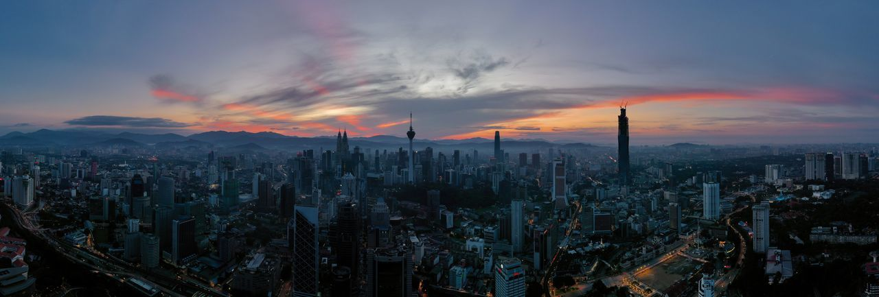 Panoramic view of modern buildings against sky during sunset