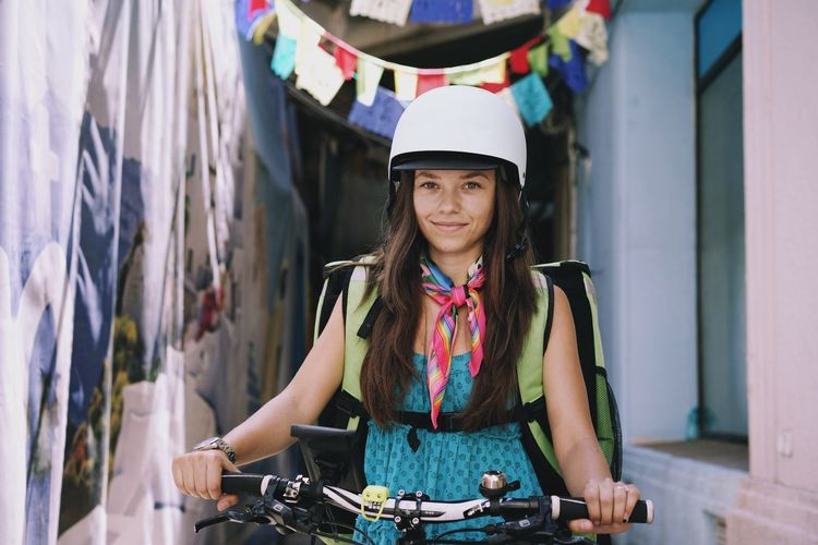 Headwear City Portrait Bicycle Standing Young Women Front View Women Business Finance And Industry Arts Culture And Entertainment Cycling Cycling Helmet Handlebar City Street Moving Riding The Modern Professional International Women's Day 2019