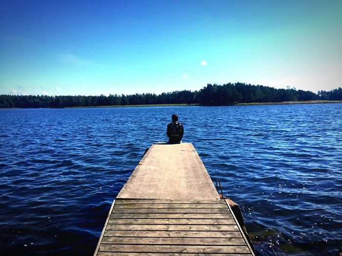 One Person Sky Water Rear View Nature Clear Sky Pier Outdoors Sitting Lake Tranquil Scene Finland Procrastinating Thinking Sunny
