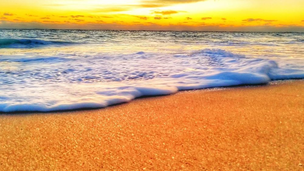 Floating dreams... EyeEm Best Shots EyeEmNewHere Market Sun Sunrise Wave Water Sea Sunset Beach Sand Multi Colored Red Sky Horizon Over Water Tide Rushing Low Tide Pebble Beach Surf Seascape