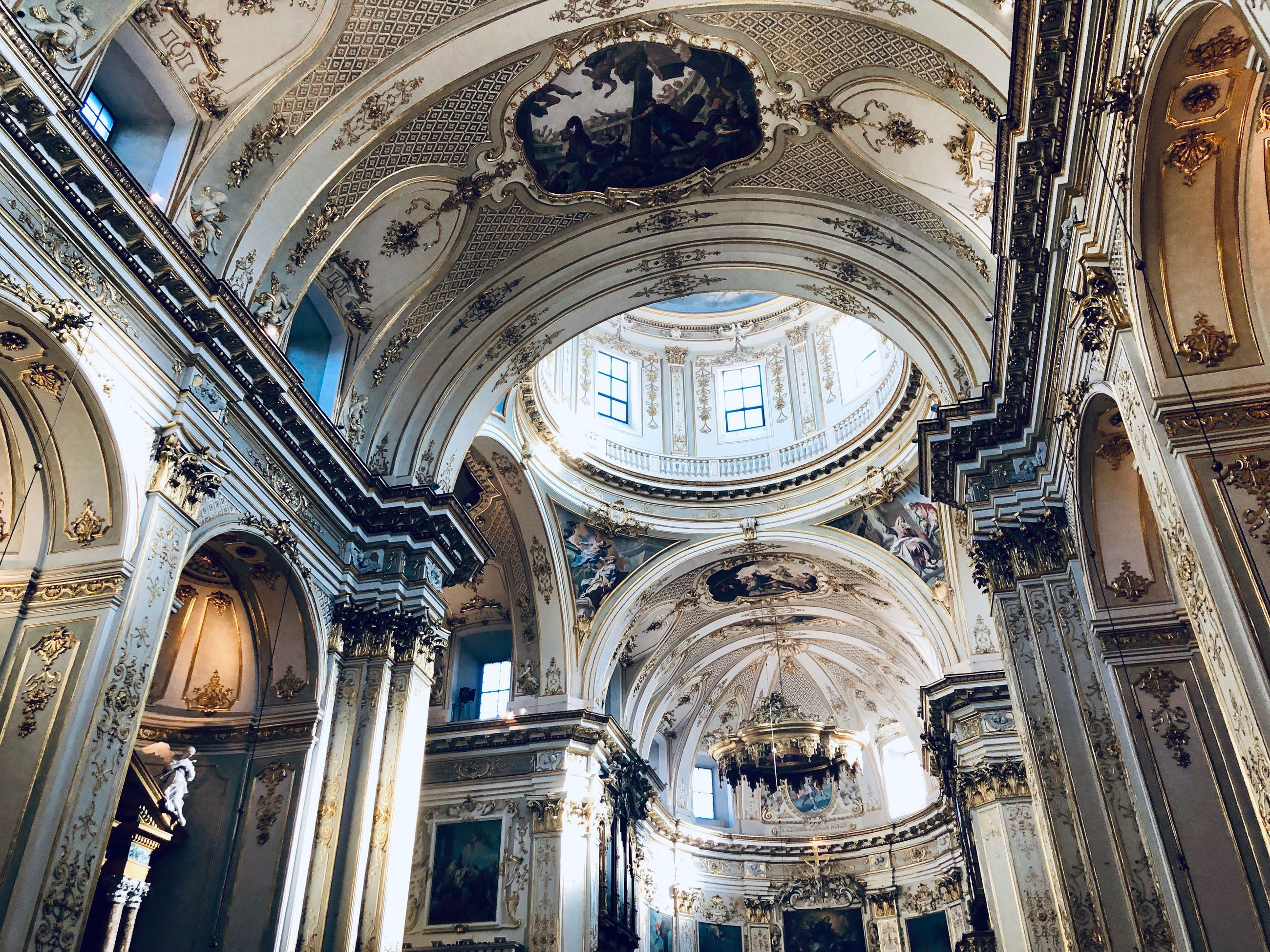 architecture, religion, built structure, place of worship, low angle view, spirituality, building, ceiling, indoors, belief, history, the past, architectural column, arch, day, no people, ornate, cupola, mural