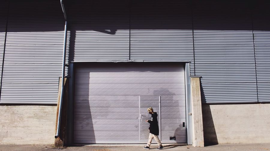 Full Length Walking Closed Lifestyles Casual Clothing Day Person Outdoors Corrugated Iron The Week Of Eyeem Light And Shadow Embrace Urban Life